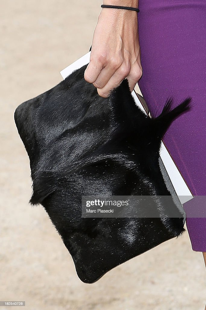 Actress <a gi-track='captionPersonalityLinkClicked' href=/galleries/search?phrase=Angie+Harmon&family=editorial&specificpeople=204576 ng-click='$event.stopPropagation()'>Angie Harmon</a> (handbag detail) attends the Elie Saab show as part of the Paris Fashion Week Womenswear Spring/Summer 2014 on September 30, 2013 in Paris, France.