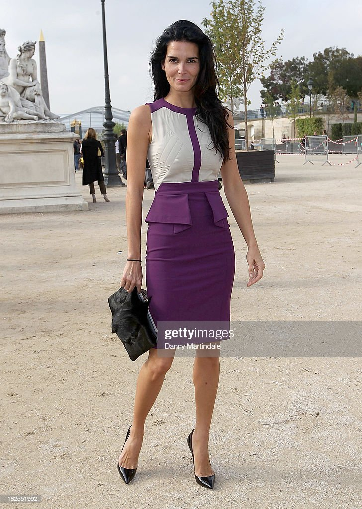 Actress <a gi-track='captionPersonalityLinkClicked' href=/galleries/search?phrase=Angie+Harmon&family=editorial&specificpeople=204576 ng-click='$event.stopPropagation()'>Angie Harmon</a> attends the Elie Saab show at Espace Ephemere Tuileries during Paris Fashion Week Womenswear Spring/Summer 2014 on September 30, 2013 in Paris, France.