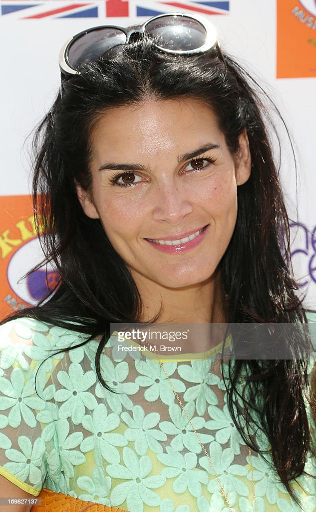 Actress <a gi-track='captionPersonalityLinkClicked' href=/galleries/search?phrase=Angie+Harmon&family=editorial&specificpeople=204576 ng-click='$event.stopPropagation()'>Angie Harmon</a> attends the Seventh Annual Kidstock Music and Art Festival to benefit One Voice Scholars, at the Greystone Mansion on June 2, 2013 in Beverly Hills, California.