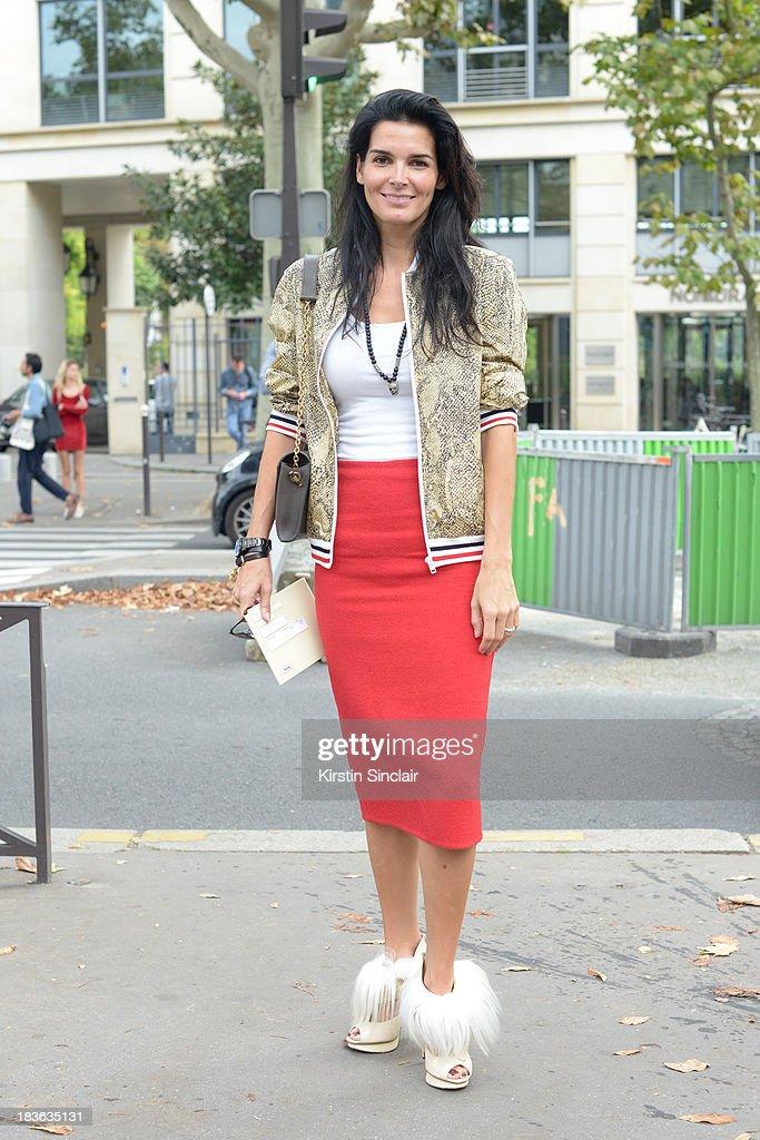Actress Angie Harmon on day 9 of Paris Fashion Week Spring/Summer 2014, Paris October 02, 2013 in Paris, France.