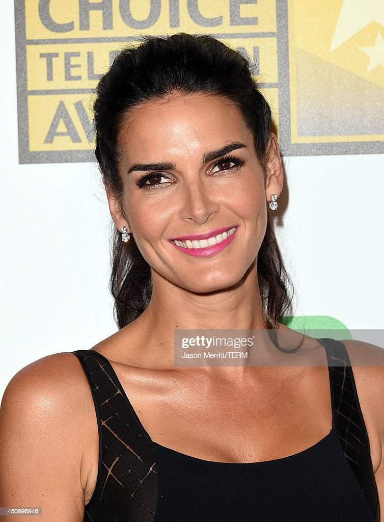 Actress Angie Harmon poses in the press room during the 4th Annual Critics' Choice Television Awards at The Beverly Hilton Hotel on June 19, 2014 in Beverly Hills, California.