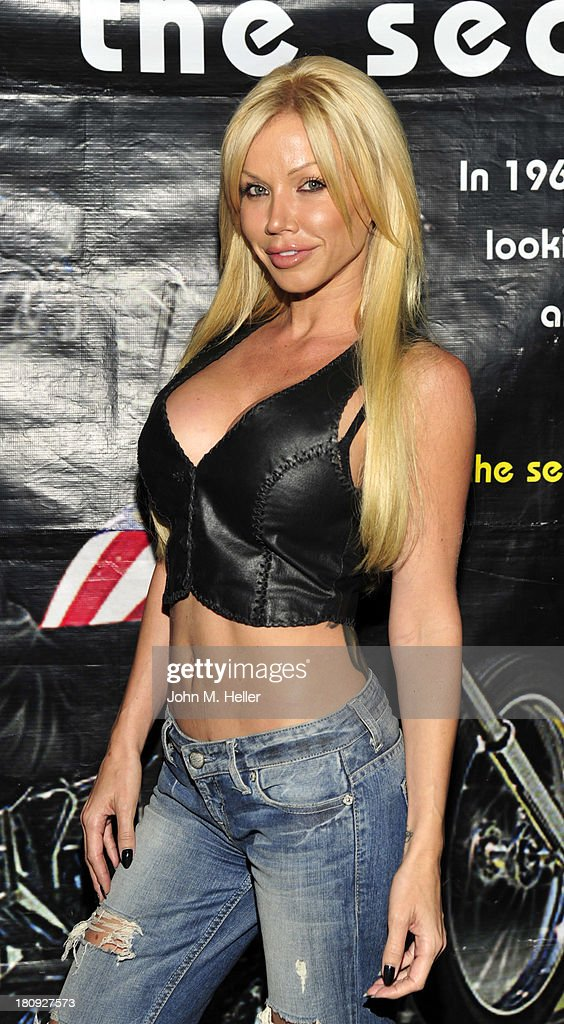 Actress Angie Savage attends the premiere of 'Easy Rider The Ride Back' Ride-In at Bartels' Harley-Davidson on September 17, 2013 in Marina del Rey, California.