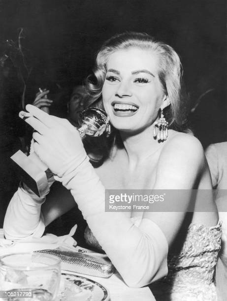 Actress Anita Ekberg poses with her Golden Globe award during the Foreign Press Awards at the Cocoanut Grove in Los Angeles California 23rd February...