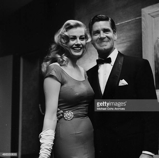 Actress Anita Ekberg with husband Anthony Steel attend the Screen Writers Dinner in Los Angeles California