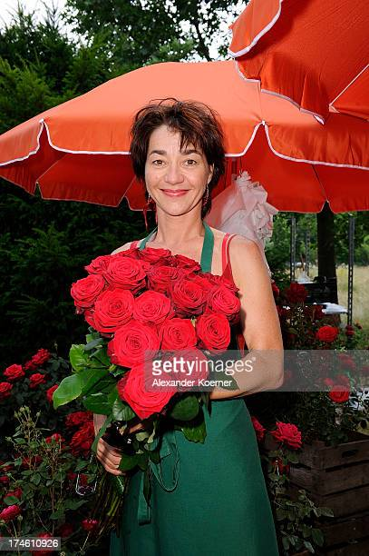 Actress Anja Franke poses with red roses during the 'Rote Rosen FanTag 2013' on July 28 2013 in Luneburg Germany More than 3500 fans of the daily...