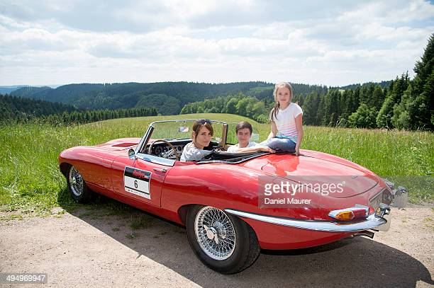 Actress Anja Kling her son Tano and daughter Alea sit in a Jaguar EType during the Ralley One on May 31 2014 in Durbach Germany