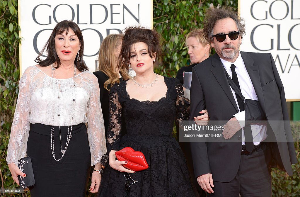 Actress Anjelica Huston, actress Helena Bonham Carter and director Tim Burton arrive at the 70th Annual Golden Globe Awards held at The Beverly Hilton Hotel on January 13, 2013 in Beverly Hills, California.