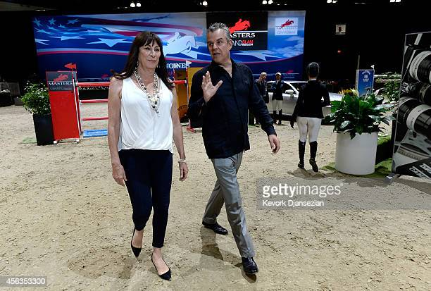 Actress Anjelica Huston and brother actor Danny Huston walk the course prior to the start of the Longines Grand Prix class event during the Longines...