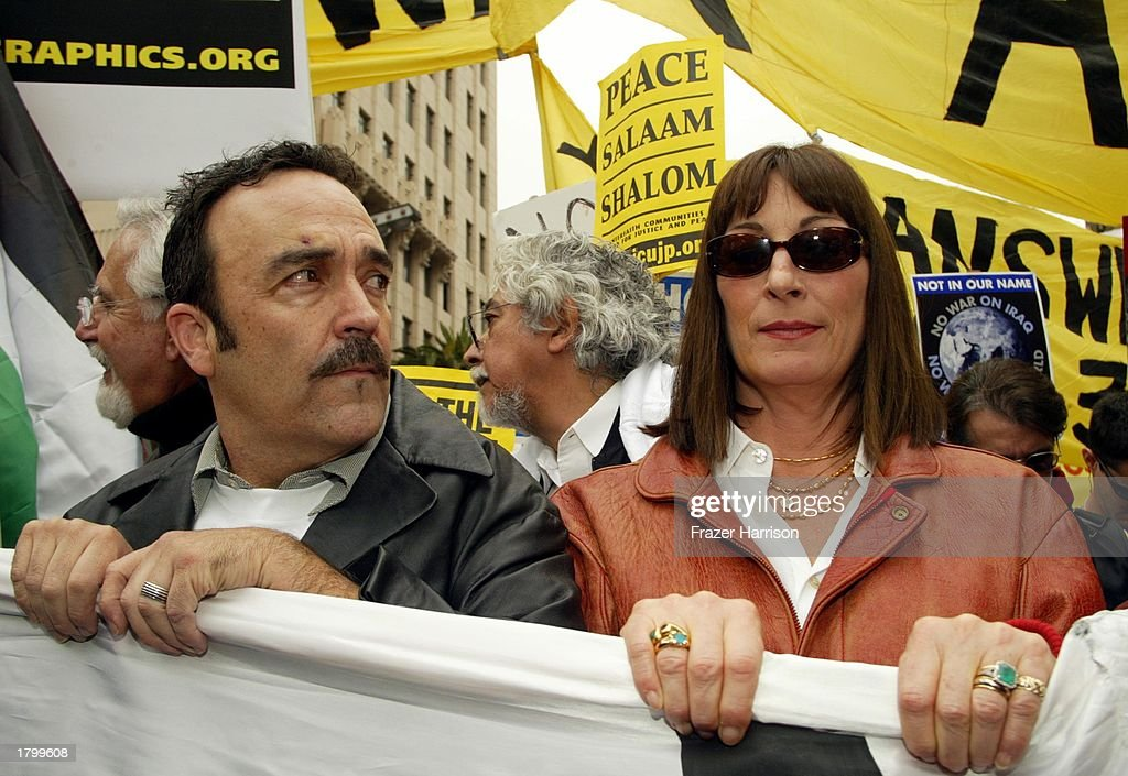 Actress Anjelica Huston (R) at the Anti War Protest on February 15, 2003 in Hollywood, Los Angeles, California.