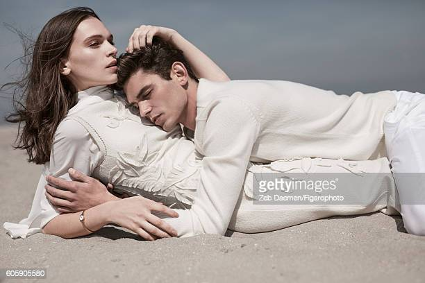 Actress Anna Brewster and model Arthur Gosse are photographed for Madame Figaro on June 24 2016 in Deauville France Arthur Sweater pants Anna Dress...