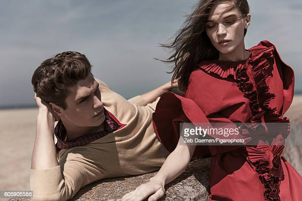 Actress Anna Brewster and model Arthur Gosse are photographed for Madame Figaro on June 24 2016 in Deauville France Arthur Sweater scarf Anna Dress...
