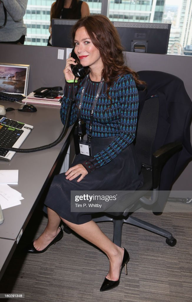 Actress <a gi-track='captionPersonalityLinkClicked' href=/galleries/search?phrase=Anna+Friel&family=editorial&specificpeople=202225 ng-click='$event.stopPropagation()'>Anna Friel</a> speaks on the phone on the trading floor during the BGC Charity Day 2013 at BGC Partners on September 11, 2013 in London, England.
