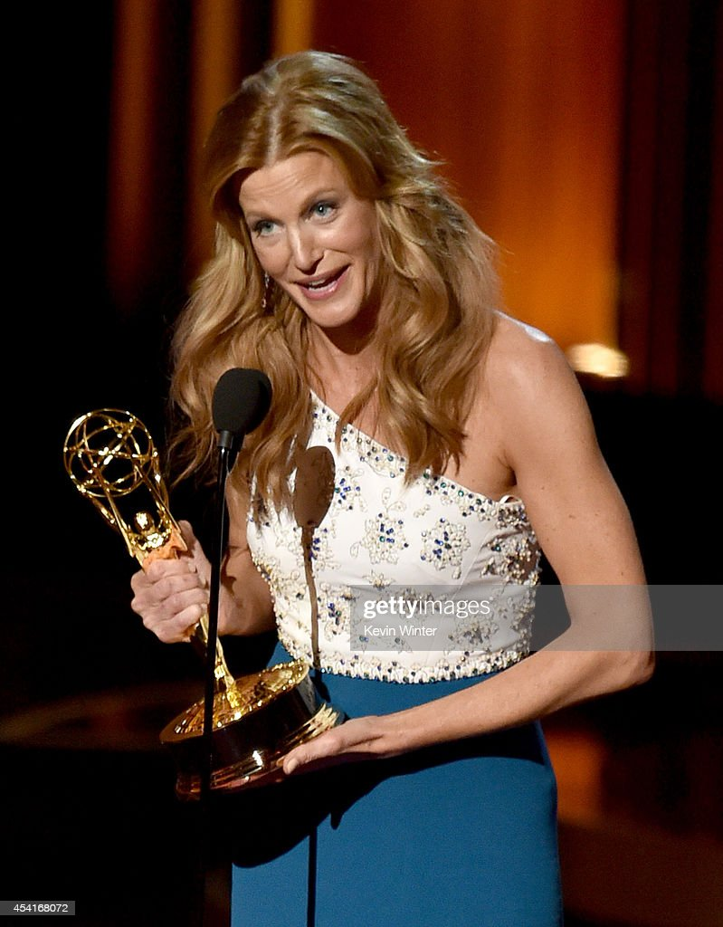 Actress Anna Gunn accepts Outstanding Supporting Actress in a Drama Series for 'Breaking Bad' onstage at the 66th Annual Primetime Emmy Awards held...