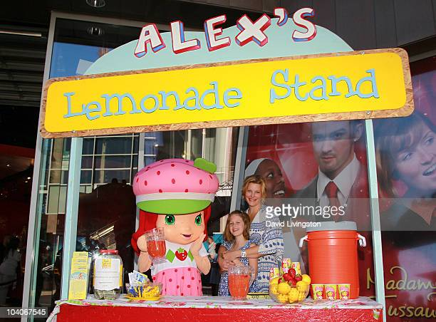 Actress Anna Gunn and daughter Emma Gunn Duncan pose with 'Strawberry Shortcake' character at the Alex's Lemonade Stand Strawberry Shortcake event...
