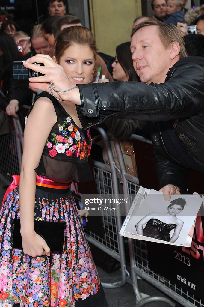 Actress <a gi-track='captionPersonalityLinkClicked' href=/galleries/search?phrase=Anna+Kendrick&family=editorial&specificpeople=3244893 ng-click='$event.stopPropagation()'>Anna Kendrick</a> poses with fan as she attends a screening of 'Drinking Buddies' during the 57th BFI London Film Festival at Odeon West End on October 18, 2013 in London, England.