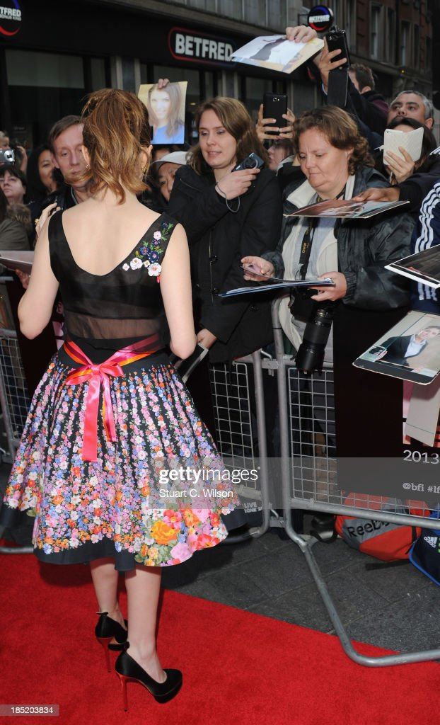 Actress <a gi-track='captionPersonalityLinkClicked' href=/galleries/search?phrase=Anna+Kendrick&family=editorial&specificpeople=3244893 ng-click='$event.stopPropagation()'>Anna Kendrick</a> signs autographs as she attends a screening of 'Drinking Buddies' during the 57th BFI London Film Festival at Odeon West End on October 18, 2013 in London, England.