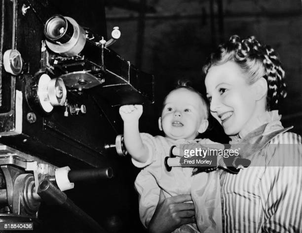 Actress Anna Lee with her baby daughter Venetia Stevenson whose father is director Robert Stevenson at Ealing Studios UK 11th March 1939 The couple...