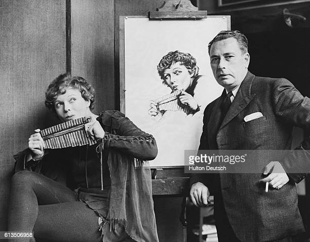 Actress Anna Neagle in her role as Peter Pan having her picture painted by Mr AL Grace in his Kensington studio London 1937