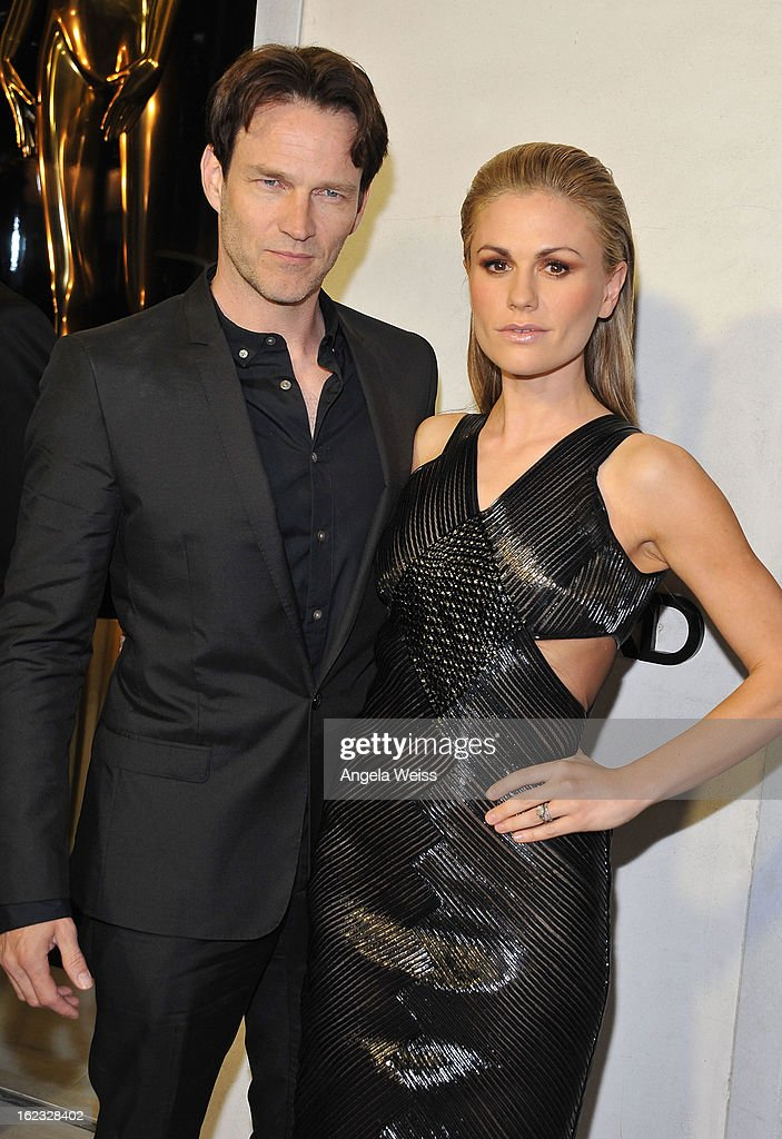 Actress <a gi-track='captionPersonalityLinkClicked' href=/galleries/search?phrase=Anna+Paquin&family=editorial&specificpeople=211602 ng-click='$event.stopPropagation()'>Anna Paquin</a> and actor <a gi-track='captionPersonalityLinkClicked' href=/galleries/search?phrase=Stephen+Moyer&family=editorial&specificpeople=4323688 ng-click='$event.stopPropagation()'>Stephen Moyer</a> attend Tom Ford's cocktail event in support of Project Angel Food at TOM FORD on February 21, 2013 in Beverly Hills, California.