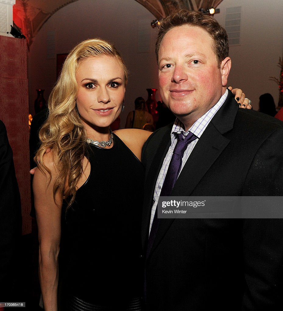 Actress <a gi-track='captionPersonalityLinkClicked' href=/galleries/search?phrase=Anna+Paquin&family=editorial&specificpeople=211602 ng-click='$event.stopPropagation()'>Anna Paquin</a> (L) and executive producer Brian Buckner pose at the after party for the premiere of HBO's 'True Blood' at the Social Club on June 11, 2013 in Los Angeles, California.