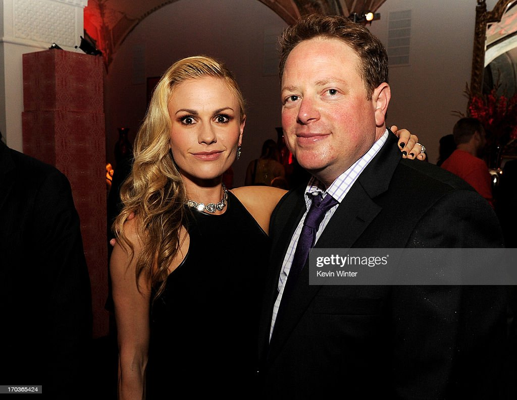 Actress Anna Paquin (L) and executive producer Brian Buckner pose at the after party for the premiere of HBO's 'True Blood' at the Social Club on June 11, 2013 in Los Angeles, California.