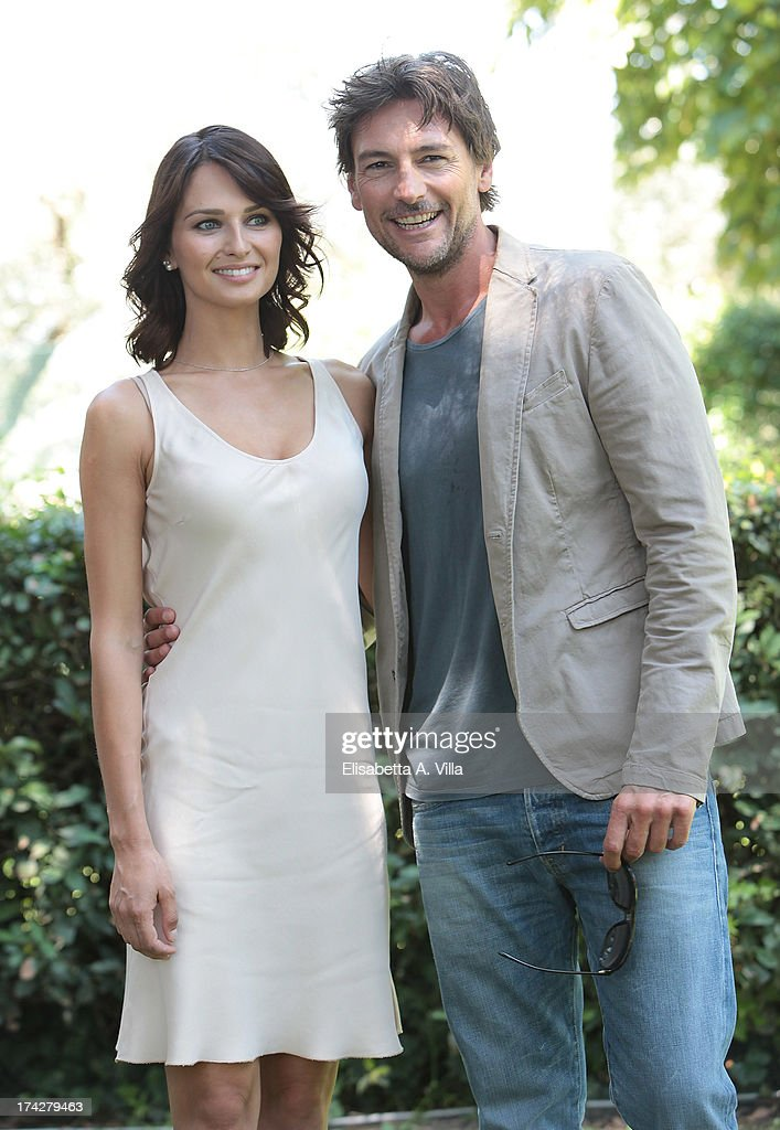 Actress Anna Safroncik and actor Roberto Farnesi attend 'La Tre Rose Di Eva 2' photocall at Mediaset Studios on July 23, 2013 in Rome, Italy.