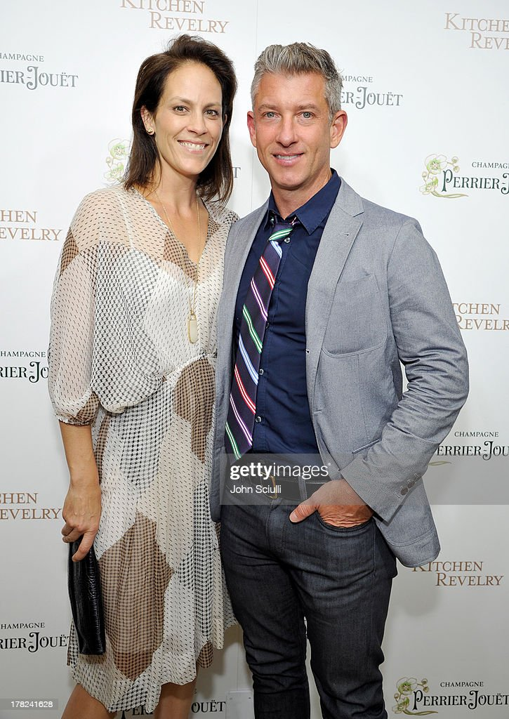 Actress Annabeth Gish (L) and Wade Allen celebrate the release of Ali Larter's new cookbook 'Kitchen Revelry' with Perrier-Jouet at Sunset Tower on August 27, 2013 in West Hollywood, California.