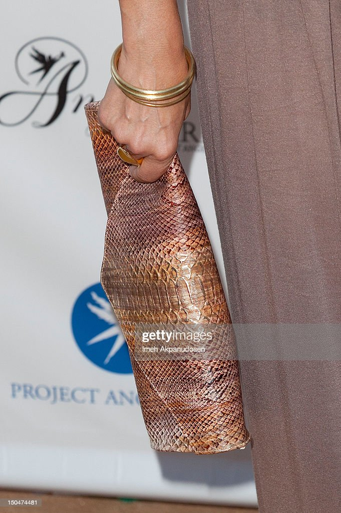 Actress Annabeth Gish (clutch & bracelet detail) attends Project Angel Food's 17th Annual Angel Awards at Project Angel Food on August 18, 2012 in Los Angeles, California.