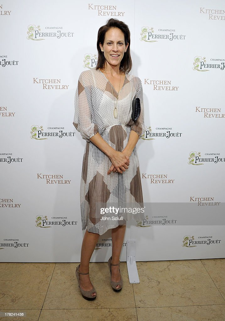 Actress Annabeth Gish celebrates the release of Ali Larter's new cookbook 'Kitchen Revelry' with Perrier-Jouet at Sunset Tower on August 27, 2013 in West Hollywood, California.