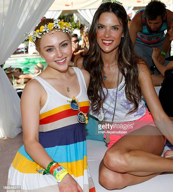 Actress AnnaSophia Robb and model Alessandra Ambrosio attend the FIJI Water At Lacoste LVE Coachella Desert Pool Party on April 13 2013 in Palm...
