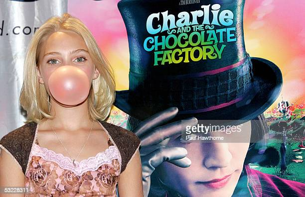 Actress AnnaSophia Robb from the new movie 'Charlie and the Chocolate Factory' blows a bubble as she hosts a bubble blowing contest at Planet...