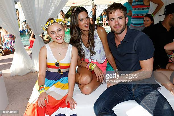 Actress AnnaSophia Robb model Alessandra Ambrosio and actor Chris Pine attend the FIJI Water At Lacoste LVE Coachella Desert Pool Party on April 13...