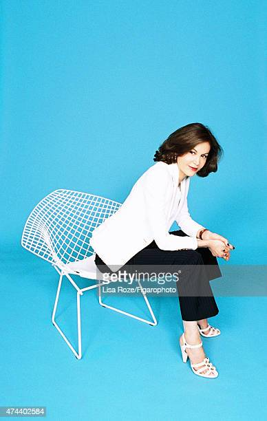 Actress Anne Fontaine is photographed for Madame Figaro on April 20 2015 in Paris France Jacket top pants shoes Bertoia Diamond chair design Harry...