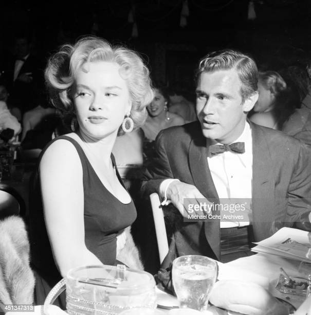 Actress Anne Francis and John Lupton attend a party in Los Angeles California