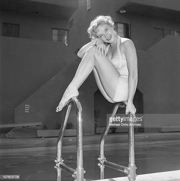 Actress Anne Francis poses by her pool on August 28 1953 in Los Angeles California