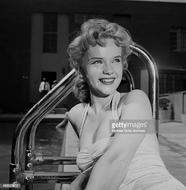 Actress Anne Francis poses by the swimming pool in Los Angeles California