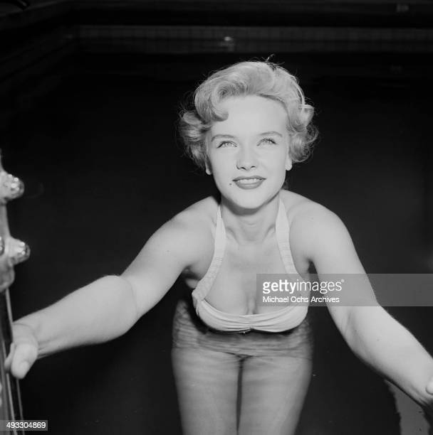 Actress Anne Francis poses in a swimming pool in Los Angeles California
