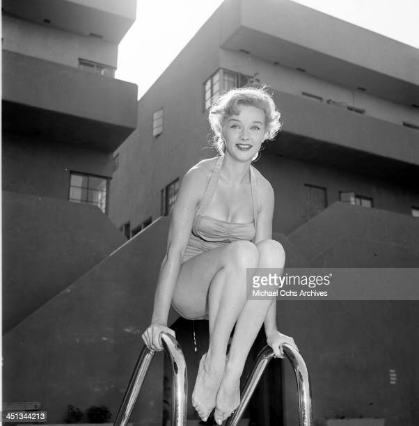 Actress Anne Francis poses in the swimming pool in Los Angeles California