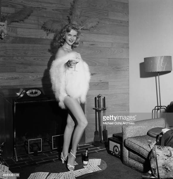 Actress Anne Francis poses with champagne in Los Angeles California