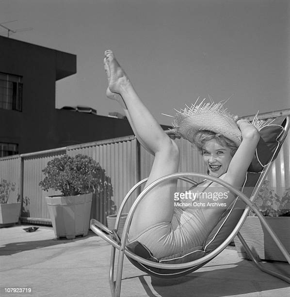 Actress Anne Francis relaxes by her pool on August 28 1953 in Los Angeles California