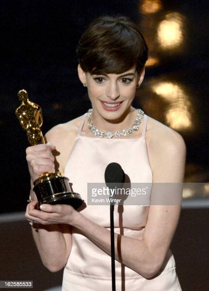 Actress Anne Hathaway accepts the Best Supporting Actress award for 'Les Miserables' onstage during the Oscars held at the Dolby Theatre on February...