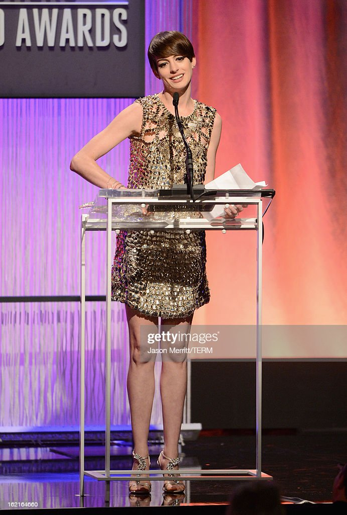 Actress <a gi-track='captionPersonalityLinkClicked' href=/galleries/search?phrase=Anne+Hathaway+-+Actress&family=editorial&specificpeople=11647173 ng-click='$event.stopPropagation()'>Anne Hathaway</a> accepts the Lacoste Spotlight Award onstage during the 15th Annual Costume Designers Guild Awards with presenting sponsor Lacoste at The Beverly Hilton Hotel on February 19, 2013 in Beverly Hills, California.