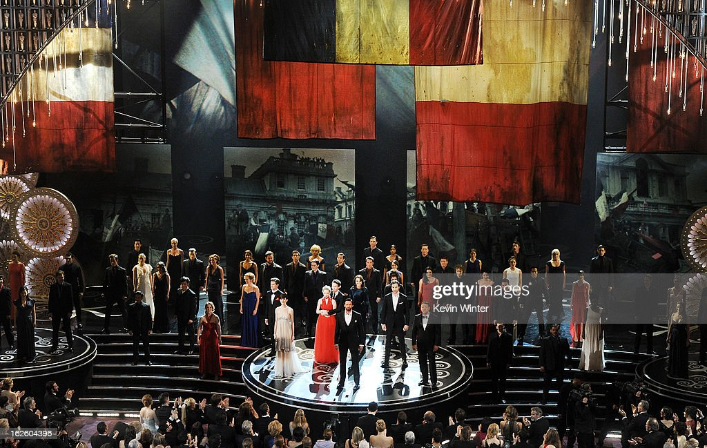 Actress Anne Hathaway, actor Hugh Jackman and actor Russell Crowe and members of the cast of Les Miserables perform onstage during the Oscars held at the Dolby Theatre on February 24, 2013 in Hollywood, California.