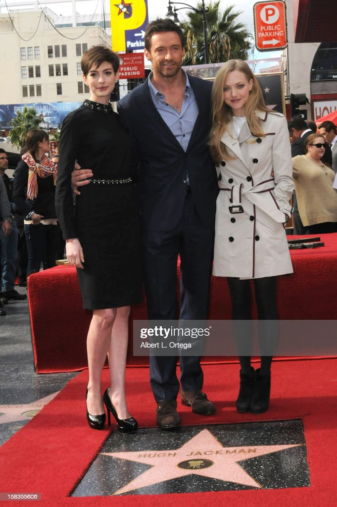 Actress Anne Hathaway, actor Hugh Jackman and actress Amanda Seyfried participate in the Hugh Jackman Star ceremony at The Hollywood Walk Of Fame on December 13, 2012 in Hollywood, California.