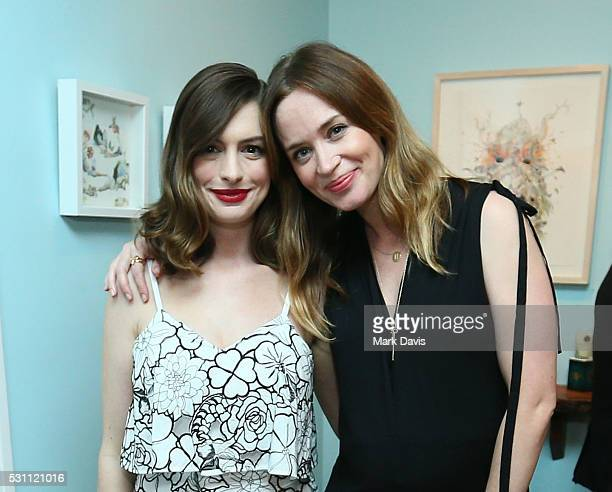 Actress Anne Hathaway and actress Emily Blunt attend Disney's Alice Through the Looking Glass event on May 12 2016 at Roseark in Los Angeles...