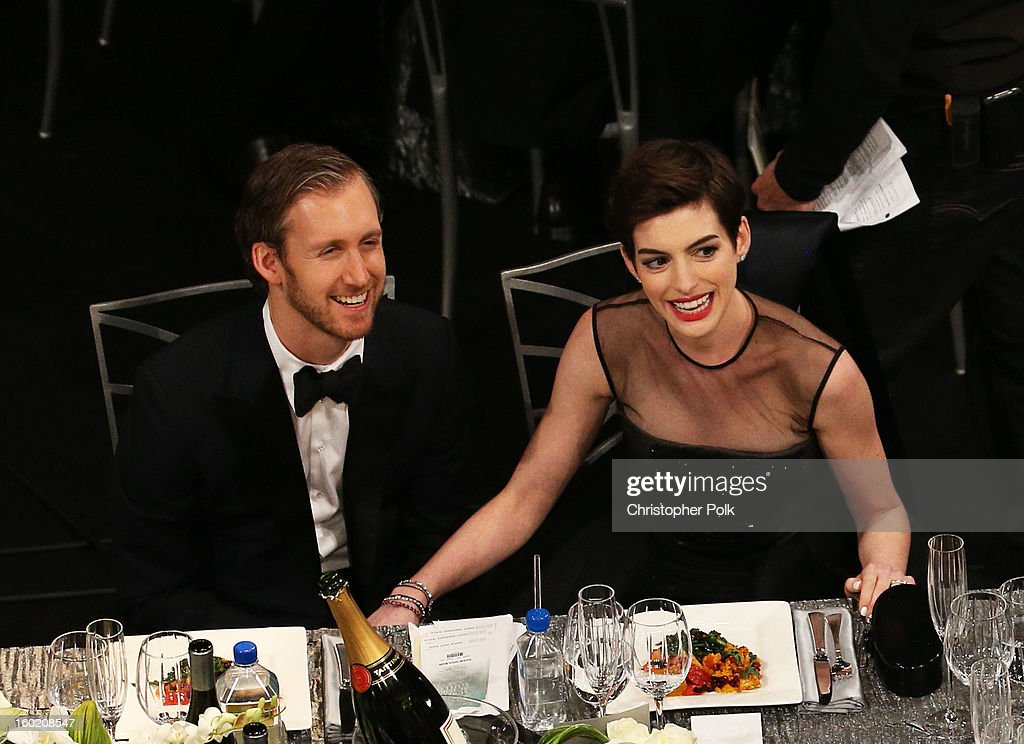Actress Anne Hathaway (R) and Adam Shulman attend the 19th Annual Screen Actors Guild Awards at The Shrine Auditorium on January 27, 2013 in Los Angeles, California. (Photo by Christopher Polk/WireImage) 23116_012_1019.jpg