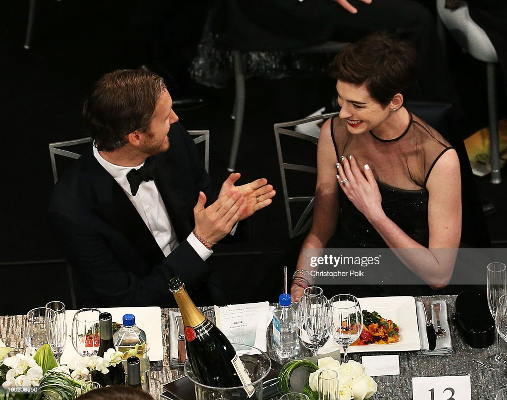 Actress Anne Hathaway (R) and Adam Shulman attend the 19th Annual Screen Actors Guild Awards at The Shrine Auditorium on January 27, 2013 in Los Angeles, California. (Photo by Christopher Polk/WireImage) 23116_012_1088.jpg
