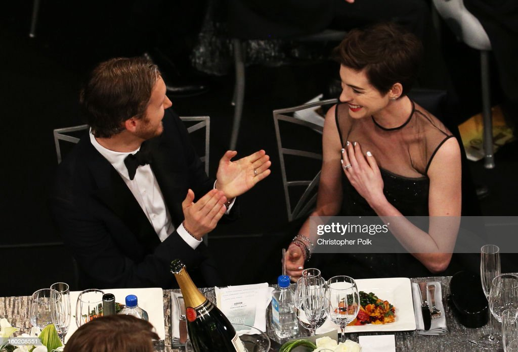 Actress Anne Hathaway (R) and Adam Shulman attend the 19th Annual Screen Actors Guild Awards at The Shrine Auditorium on January 27, 2013 in Los Angeles, California. (Photo by Christopher Polk/WireImage) 23116_012_1090.jpg