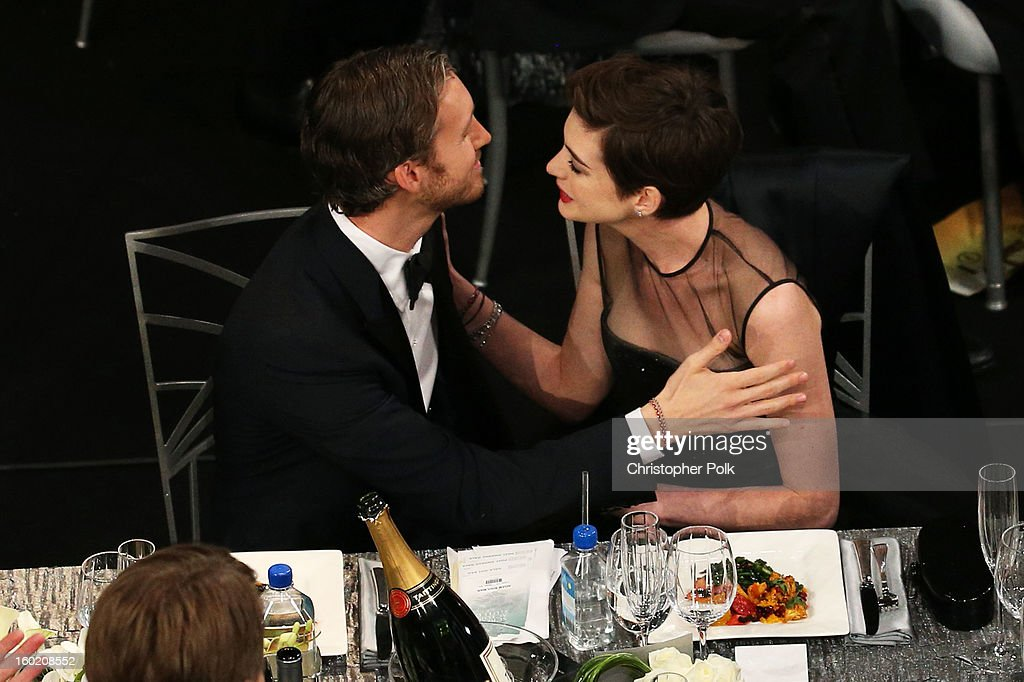 Actress Anne Hathaway (R) and Adam Shulman attend the 19th Annual Screen Actors Guild Awards at The Shrine Auditorium on January 27, 2013 in Los Angeles, California. (Photo by Christopher Polk/WireImage) 23116_012_1100.jpg