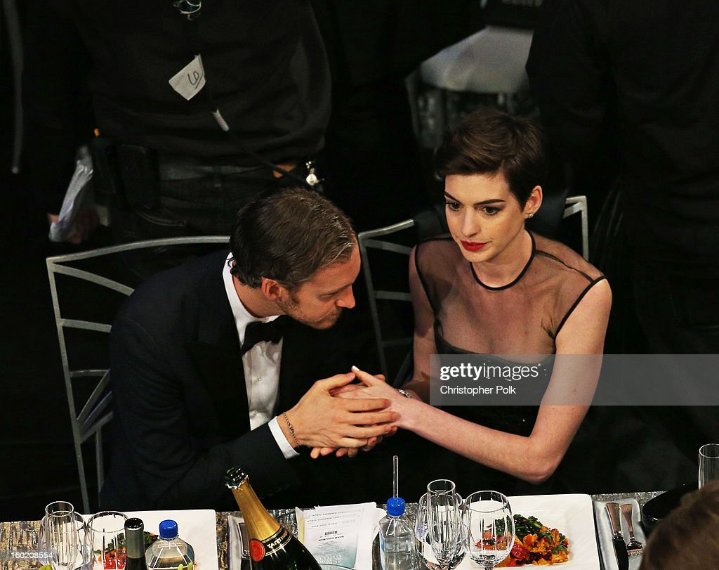 Actress Anne Hathaway (R) and Adam Shulman attend the 19th Annual Screen Actors Guild Awards at The Shrine Auditorium on January 27, 2013 in Los Angeles, California. (Photo by Christopher Polk/WireImage) 23116_012_1011.jpg
